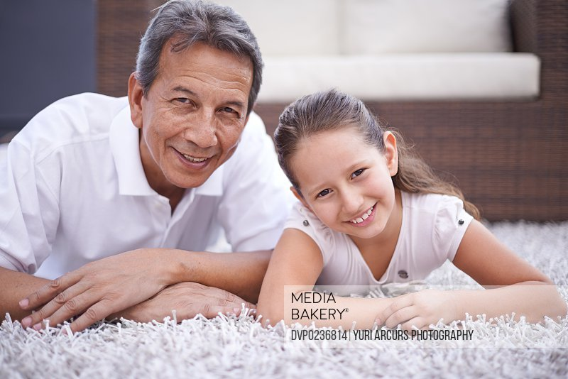Portrait of a young girl and her grandfather