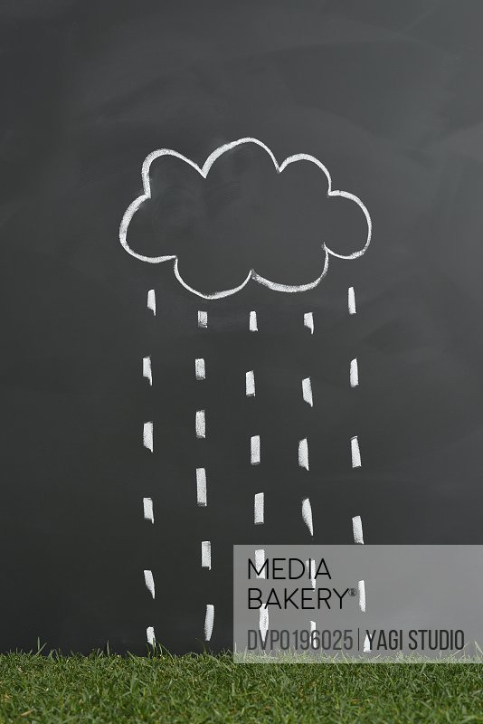 Clouds and rain are falling lawn on a blackboard