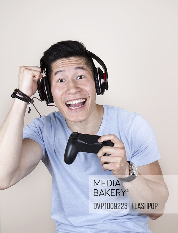 Man playing with games console