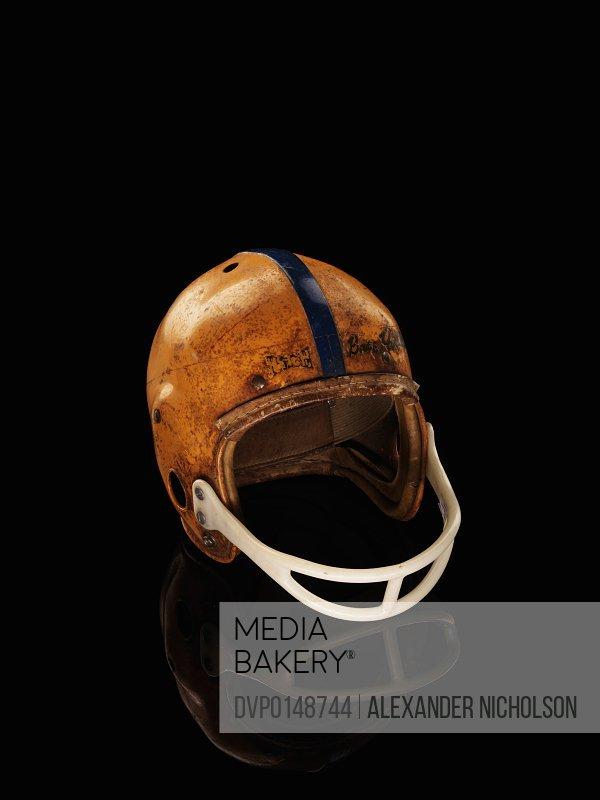 old football helmet on black background