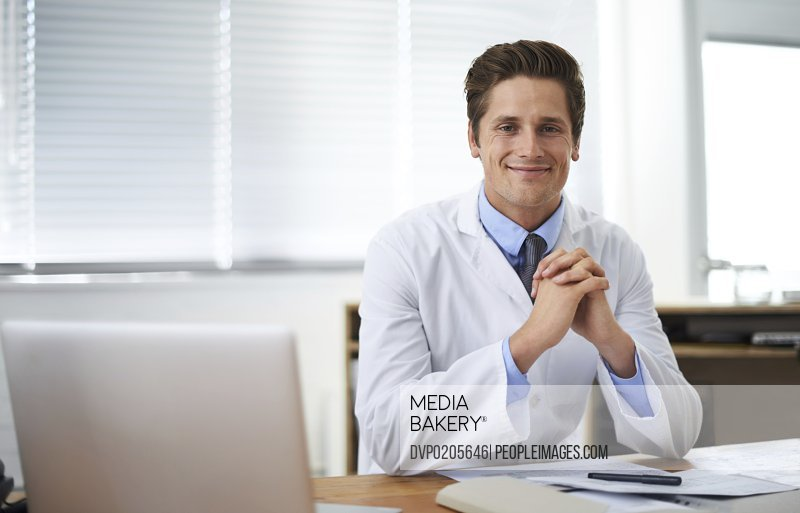 Positive young medical professional