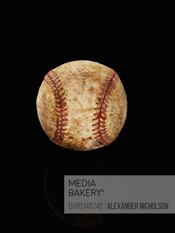 old baseball on back background
