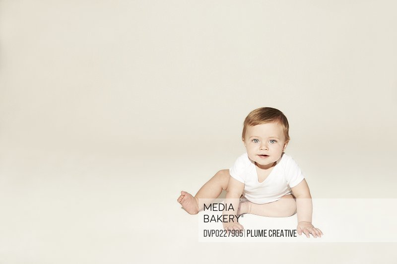 Cute baby crawling on the floor
