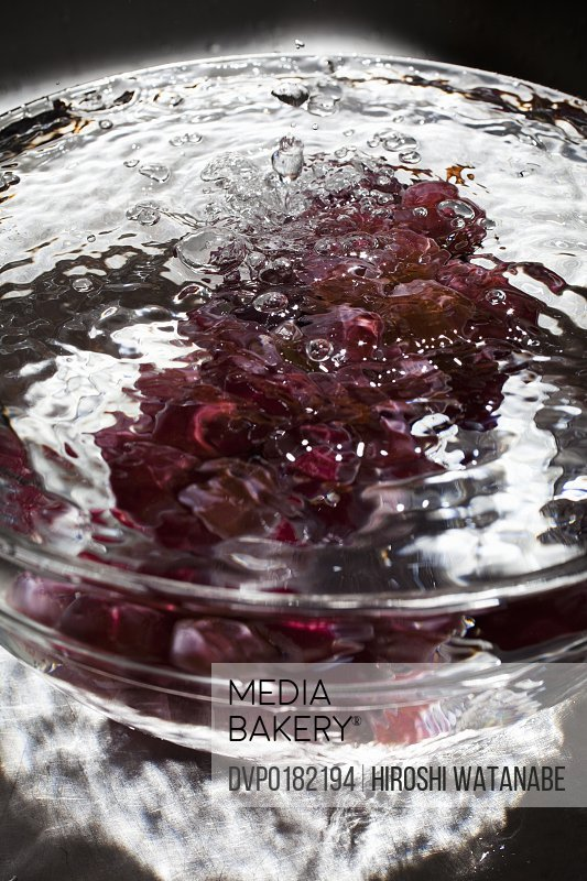 Grapes in a ball with water splash