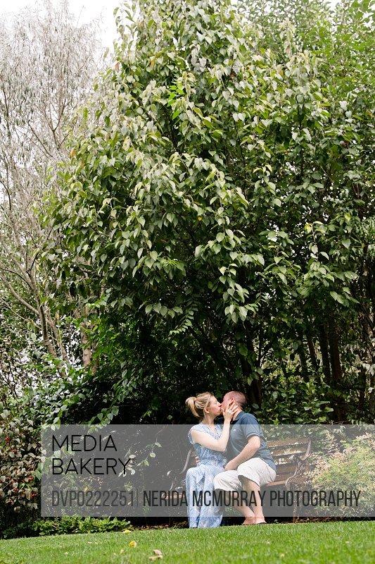 Man Woman kissing under tree