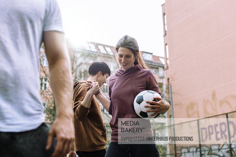 Woman Playing Urban Soccer