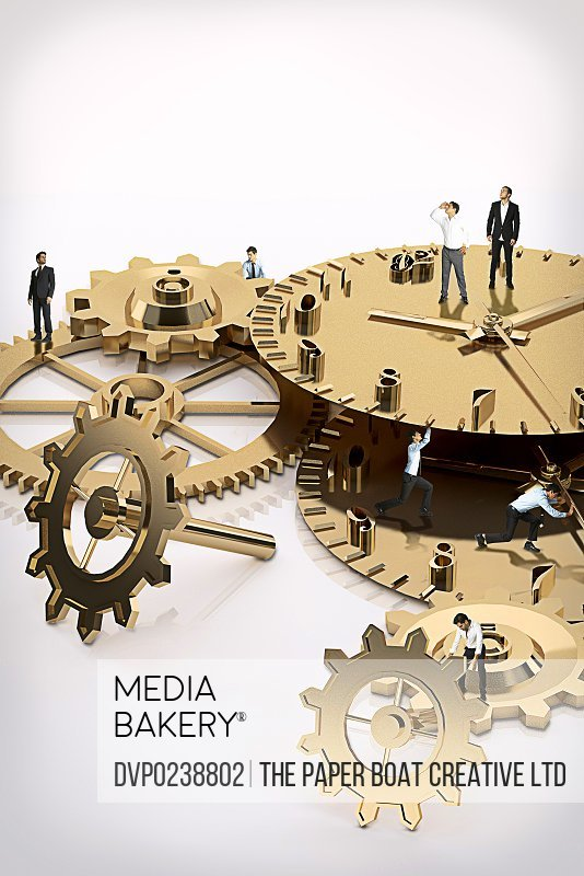 Businessmen standing on giant clock parts