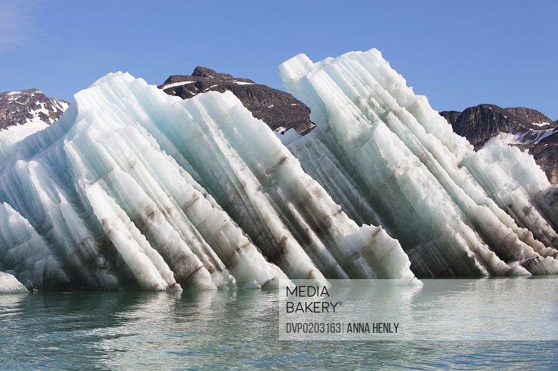 Iceberg streaked with rock debris