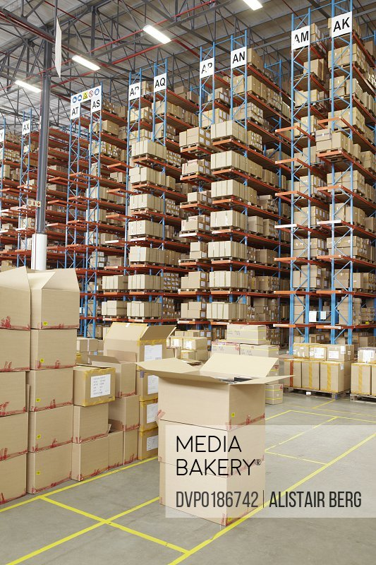Boxes and racking inside a modern warehouse storing boxes of clothing