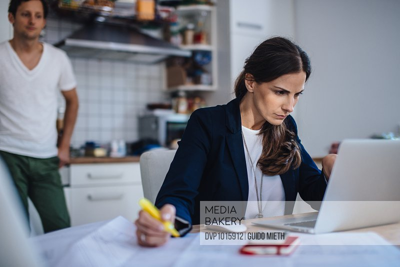 Woman working at home.