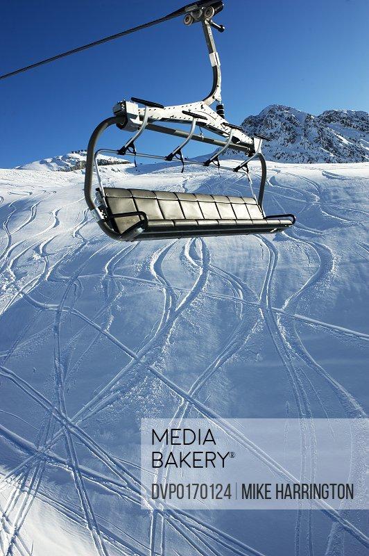 View of ski lift passing over La Plagne Mountain Ski Tracks