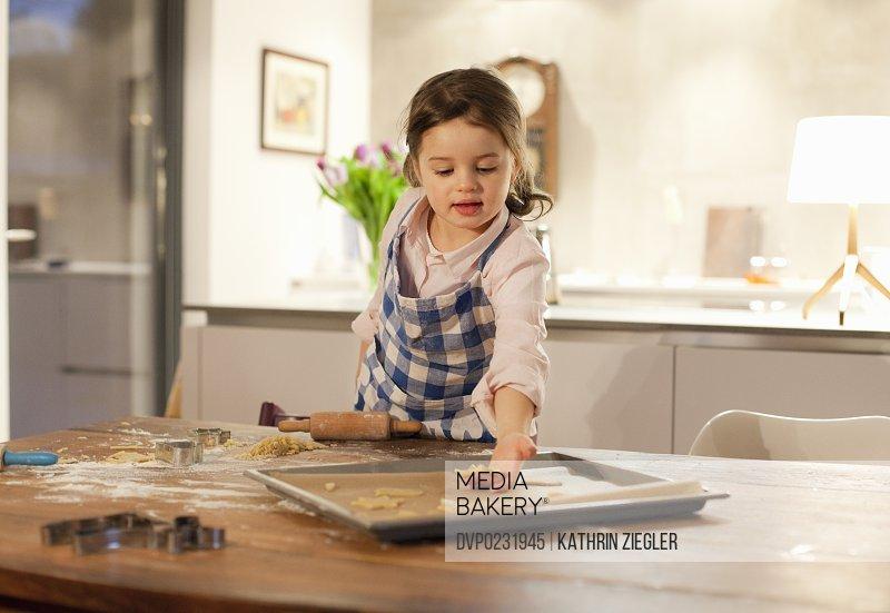 little girl making cookies