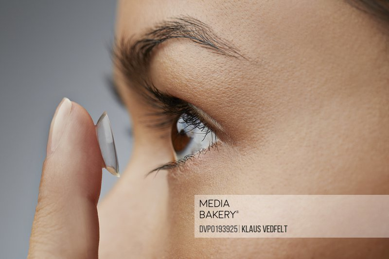 Close-up of woman putting in contact lens