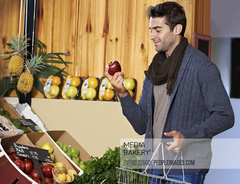 Shot of a young man in a supermarket shopping for fresh produce