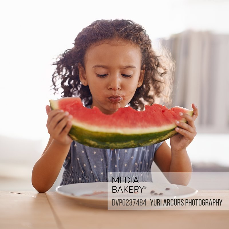 Shot of a cute little girl eating watermelon