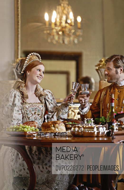 A regal king and queen enjoying a meal together