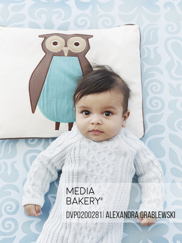 Baby with Head on Owl Pillow