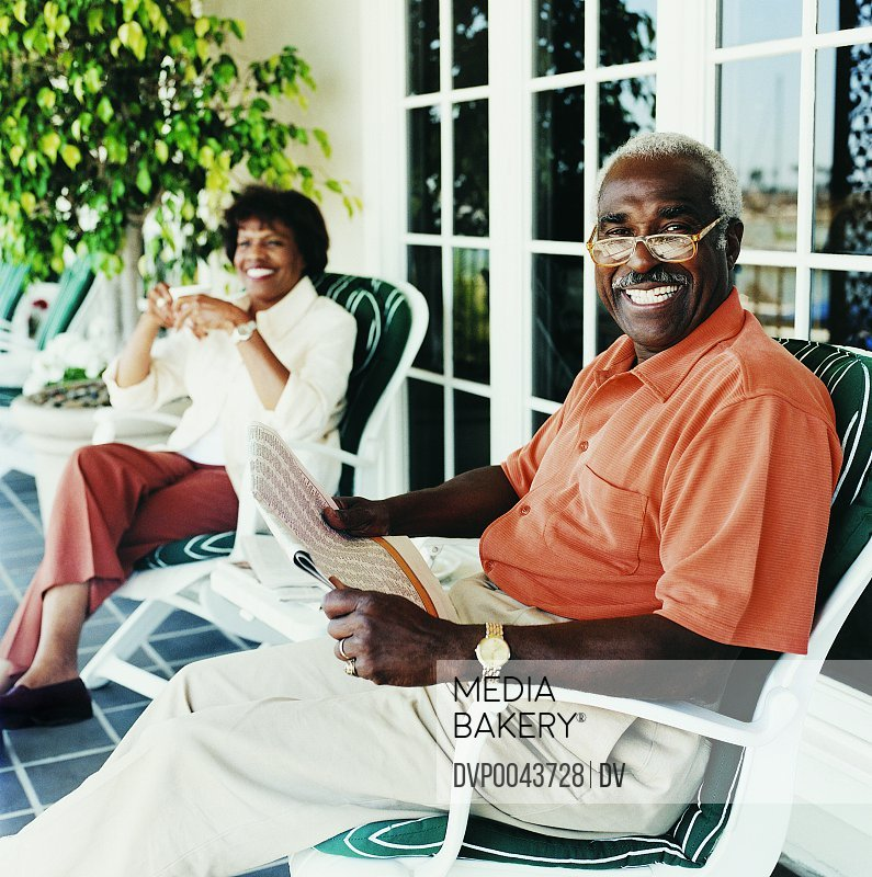 Elderly Couple Sitting Relaxing on Outdoor Patio