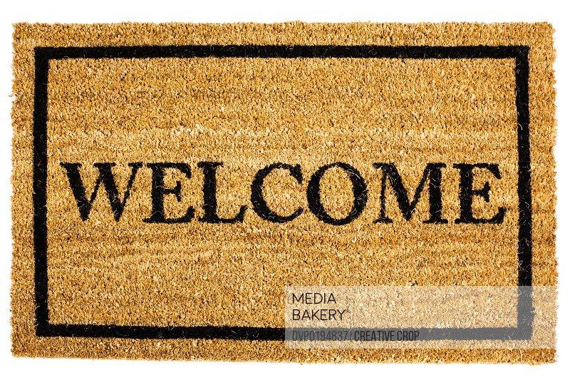 Door mat with welcome sign