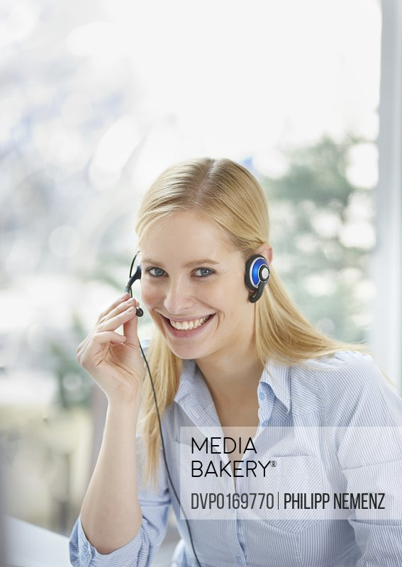 women with headset smiling