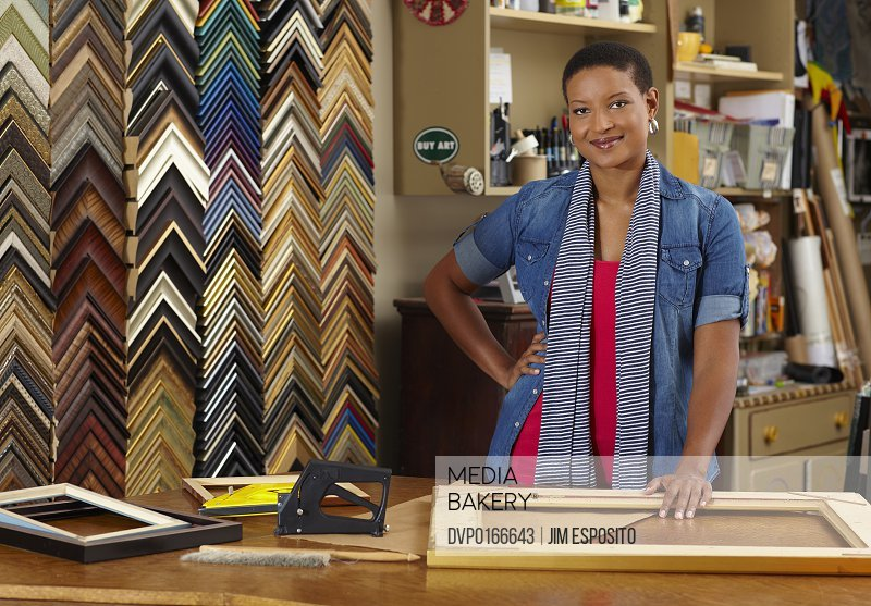 A portrait of a frame shop owner