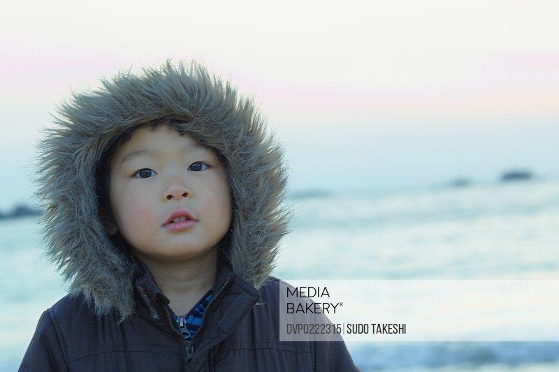 Children standing in the rising sun seaside