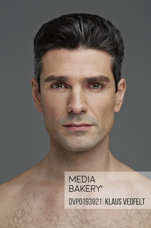 Beauty portrait of man looking confident in camera