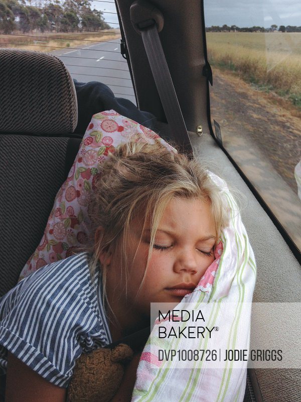 Child sleeping in the back seat of a car