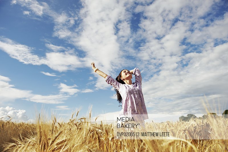 female happy in cornfield