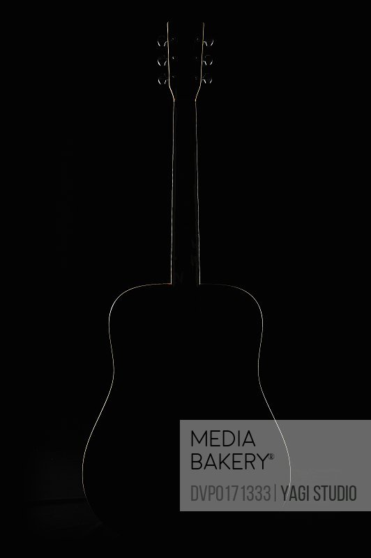The silhouette of acoustic guitar black backgrou