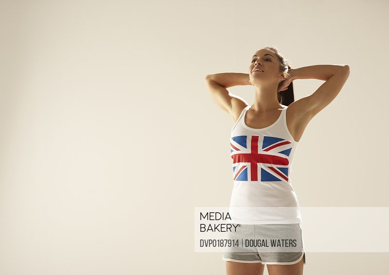Woman with Union Jack vest and hands behind head