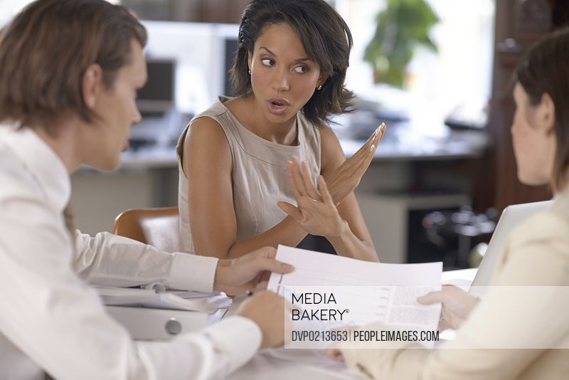 Attractive businesswoman disagreeing with her coworkers