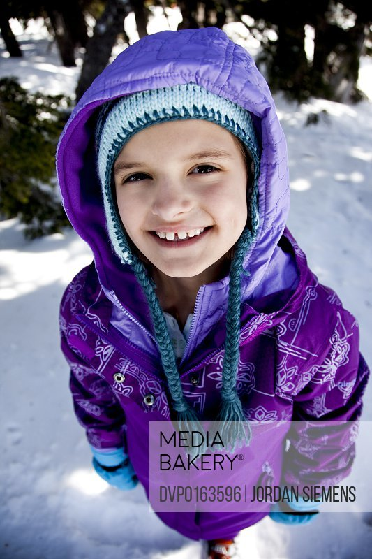 Young girl having fun in winter.