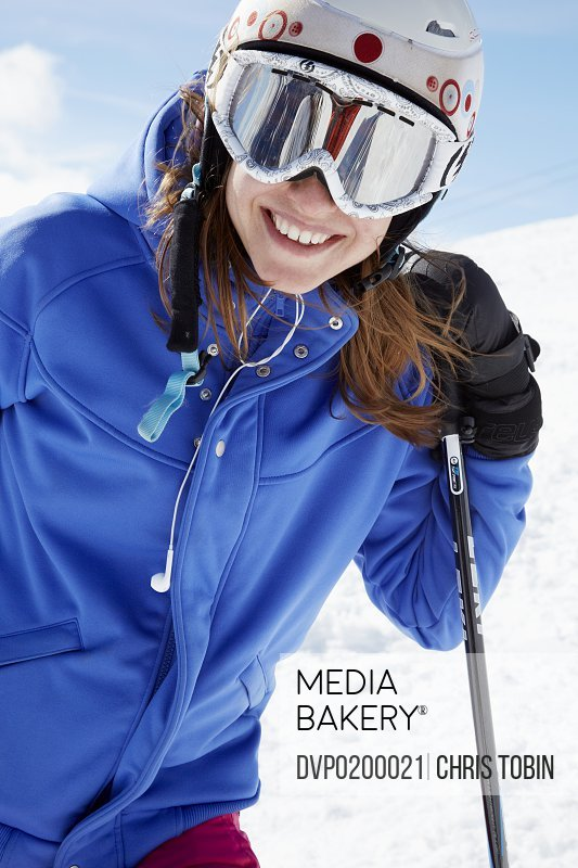 Young woman with ski gear in the snow