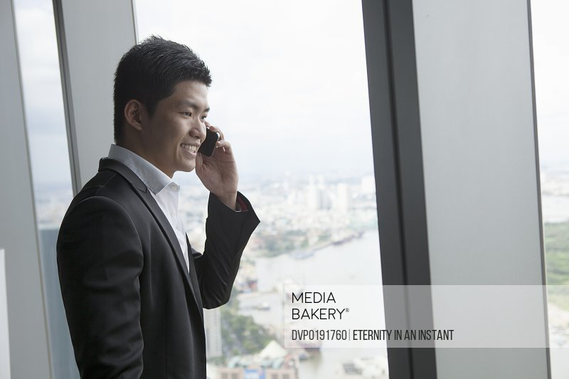 Asian Businessman holding smartphone