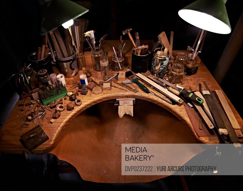 A high angle view of a wooden desk covered in tools