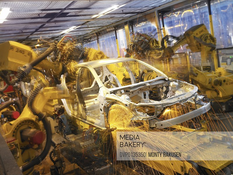 Car Part Being Welded by Automated Robots on an Assembly Line