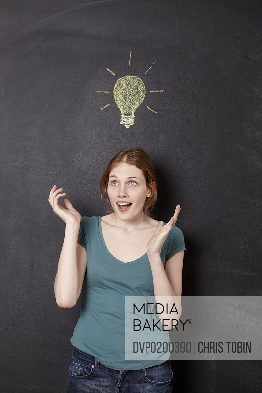 Surprised girl with idea light bulb