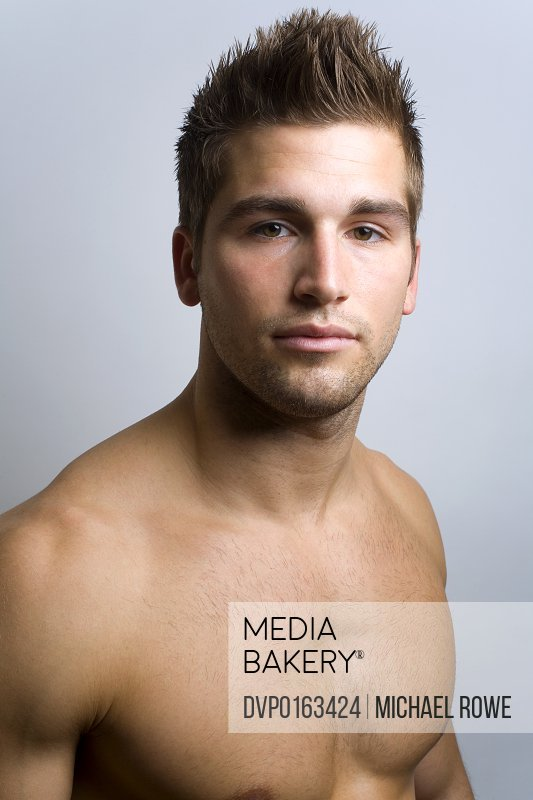 Close up portrait of a young shirtless Caucasian male.
