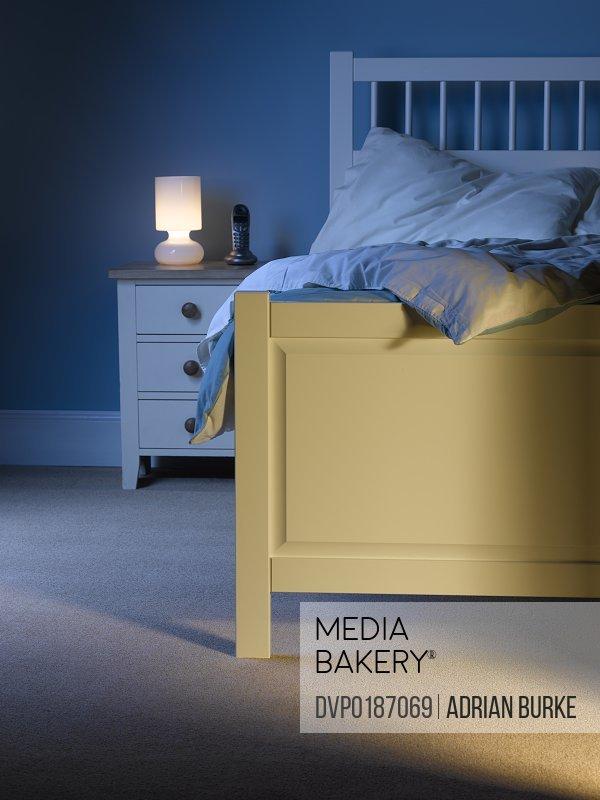 Shaft of light from open door into bedroom