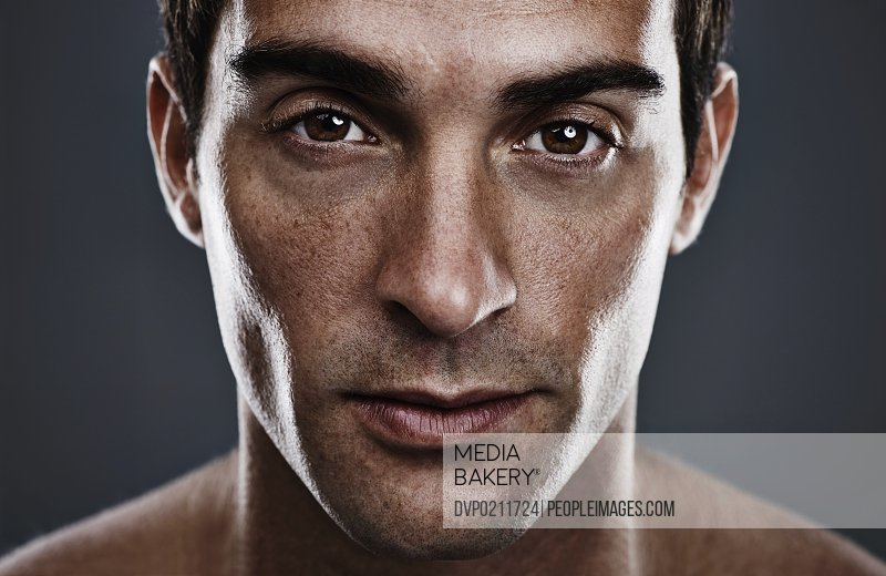 Closeup studio portrait of a handsome young man