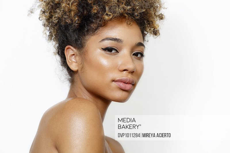 Female model with clean makeup and afro updo