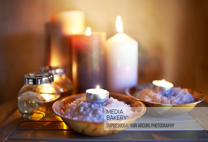 An arrangement of scented candles, salts and oils at a spa