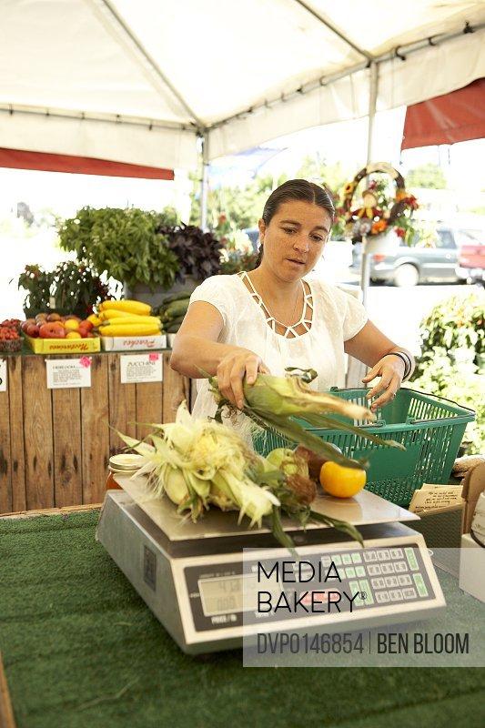 Woman buying produce at Farm Market