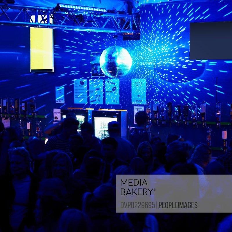 Shot of revelers dancing inside a nightclub