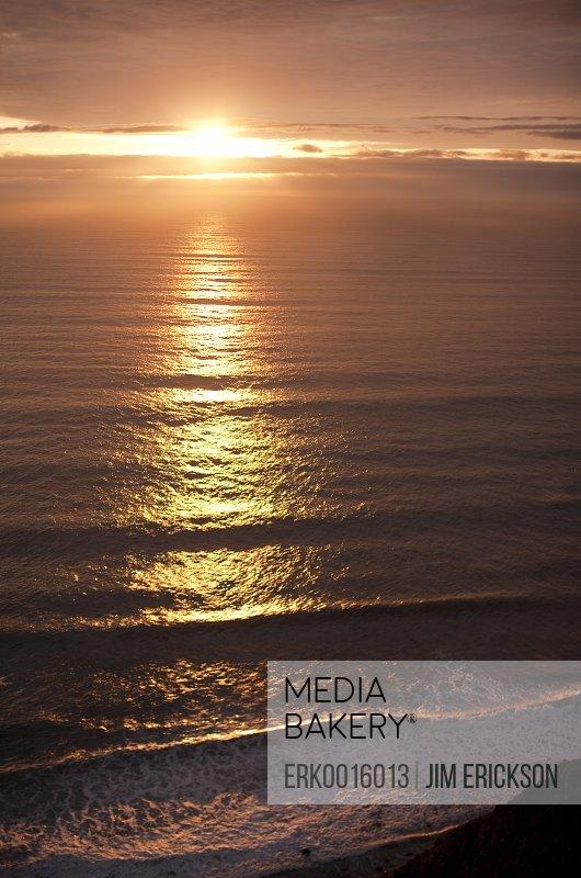 Setting sun reflected on sea.
