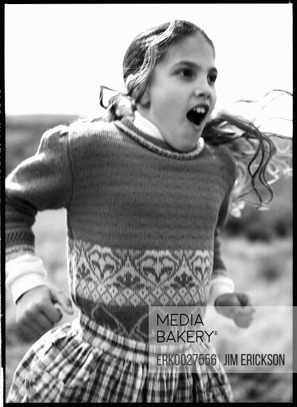 Discover- A girl is jumping with joy.