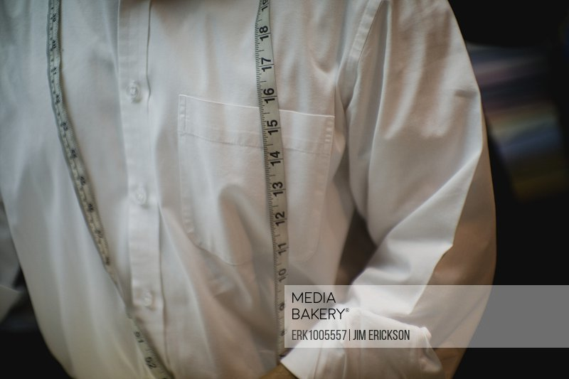 Man's white shirt with a tape measure draped across it.