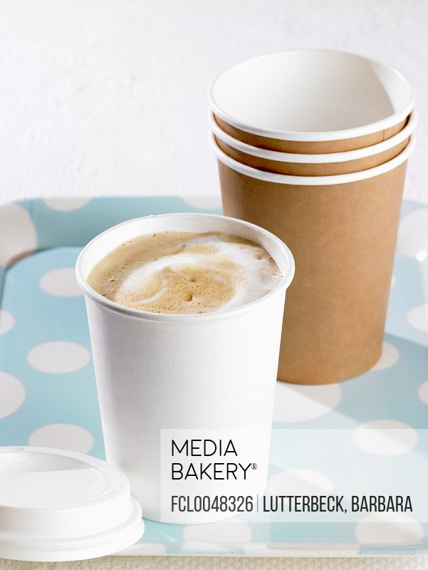 Cappuccino in paper cup to take away