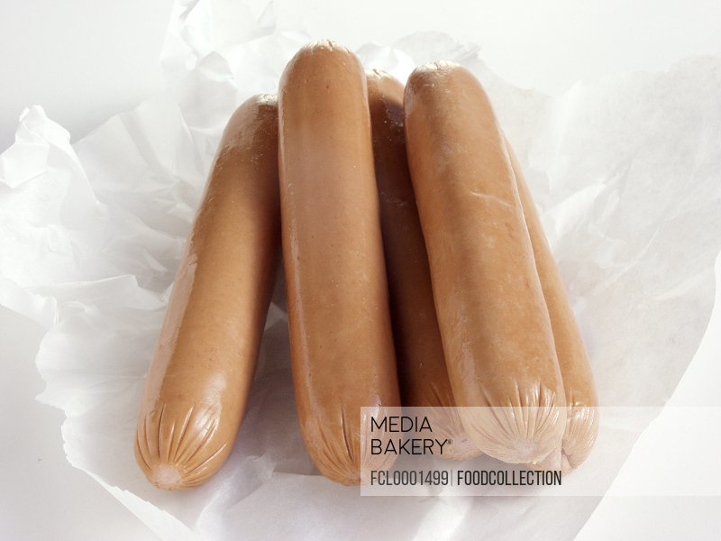 Uncooked Hot Dogs on Paper